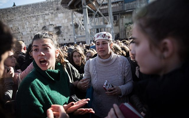 Women of the Wall and protesters against them at the Western Wall in Jerusalem's Old City, March 8, 2019.