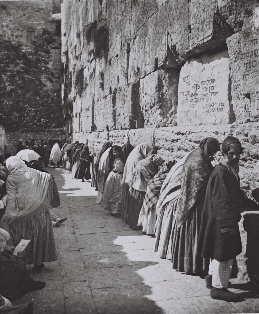 Western wall with men and women praying side by side in 1910.