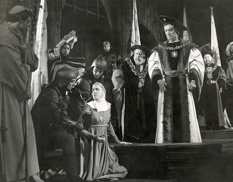 Isabella kneels before the Duke and begs for forgiveness on Angelo's behalf, Act 5 Scene 1 of Measure for Measure. Photo by Angus McBean © RSC.