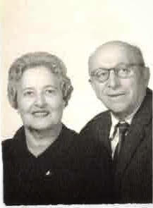 Black and white image of an elderly woman and man.