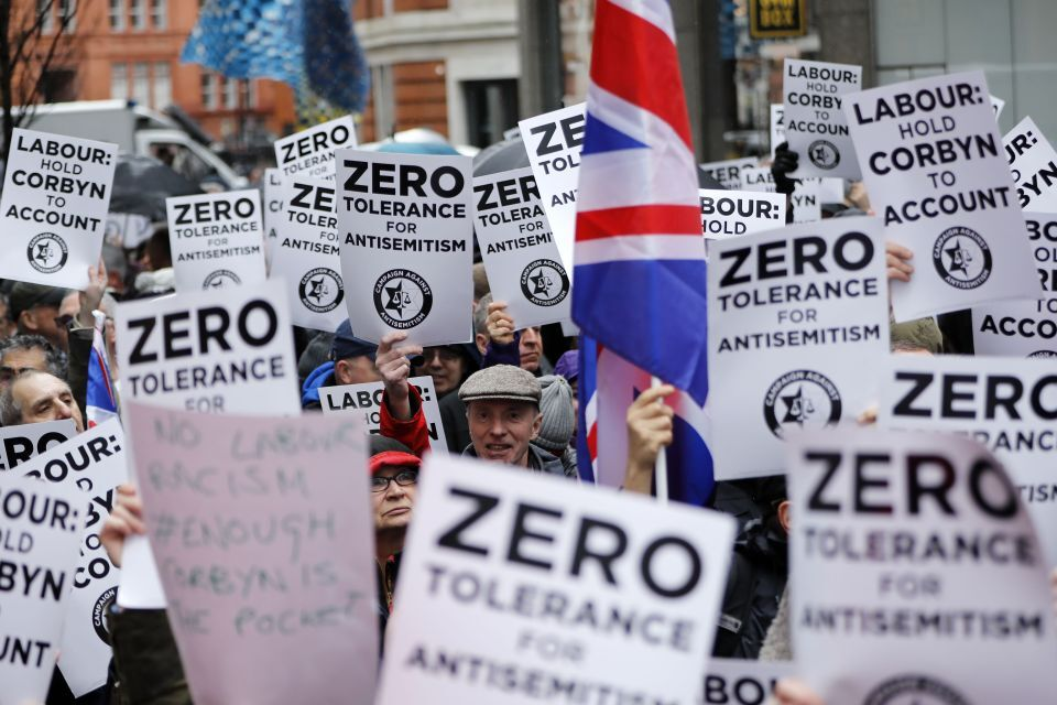 "Image shows protestors holding signs that say ""Zero Tolerance for Anti-Semitism"""