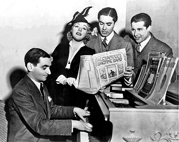 Irving Berlin and the stars of Alexander's Ragtime Band, 1938. Standing from left: Alice Faye, Tyrone Power, and Don Ameche. (The Boston Globe and Wikimedia.)