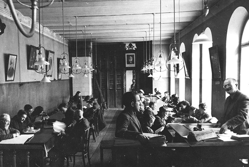 The main reading room of the Strashun Library. The librarian, Isaac Strashun, stands in the foreground, right. (Courtesy of the Archives of the YIVO Institute for Jewish Research, New York.)