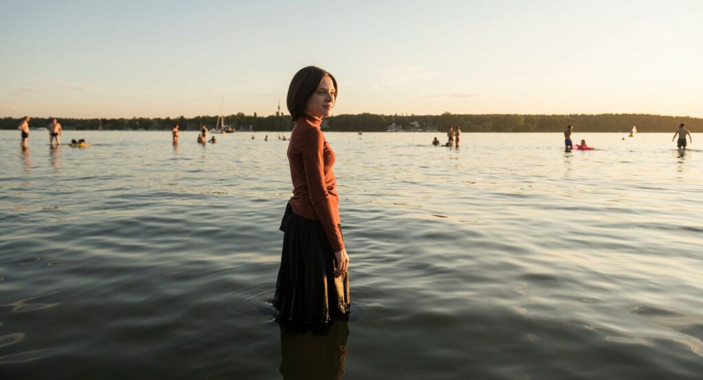 Shira Haas  (Esty) stands in Berlin's Lake Wansee. (Courtesy of Anika Molnar/Netflix.)