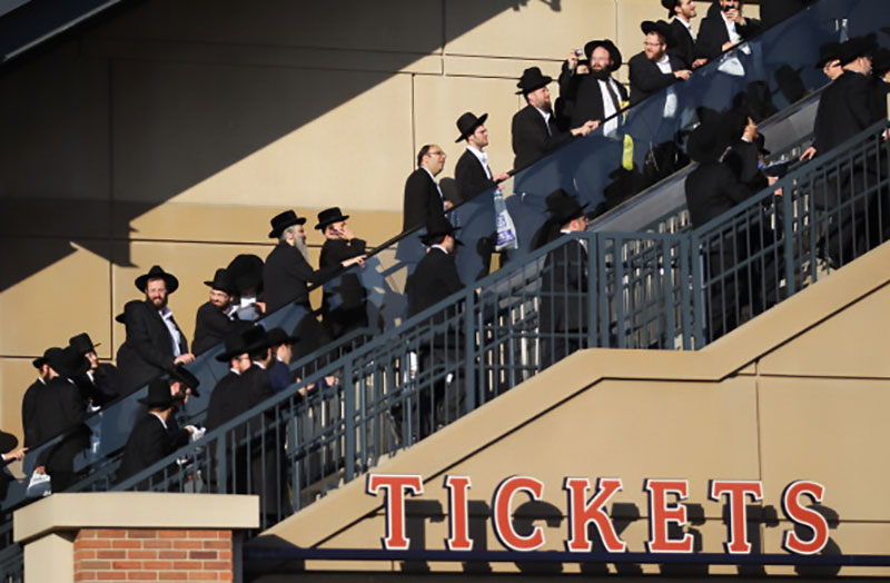 Ultra-Orthodox Jews enter Citi Field in New York to rally against the dangers the Internet, May 20, 2012. 40,000 men filled the stadium. (Photo by Mario Tama/Getty Images.)
