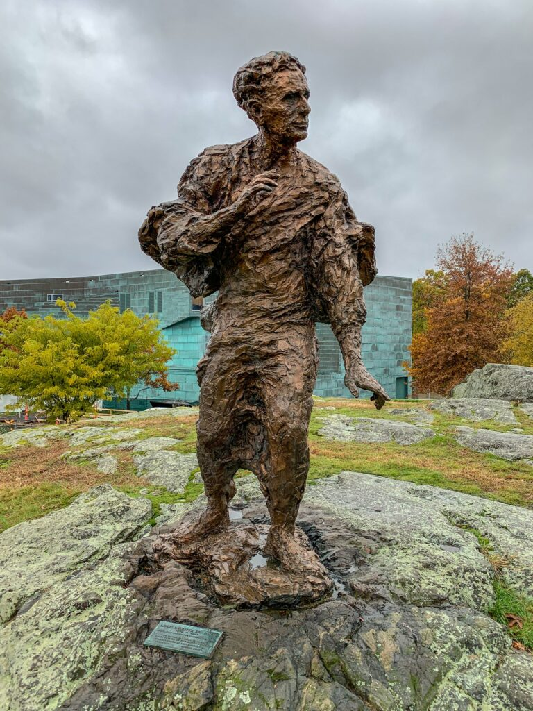 Statue of Justice Louis Brandeis atop the outcropping called Boston Rock at Brandeis University. The nine-foot bronze was created in 1956 by sculptor Robert Berks.